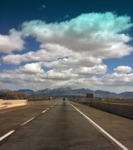 The iPhone warns of cloudy skies ahead as we motor north through New Mexico toward a frostbitten Santa Fe.