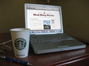 The very latest in Road Trip Breakfast Technology (circa 2005): a cup of Starbucks and a 12-inch G4 PowerBook.