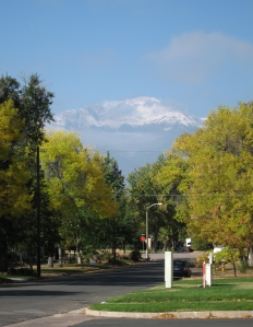 One shot, three seasons: Summer in the lawn, fall in the trees and winter on Pikes Peak.
