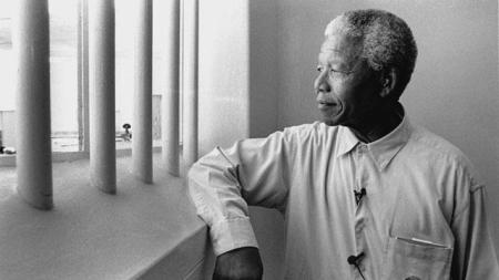 Nelson Mandela, shown visiting his old prison cell on Robben Island in 1994. Photo: Lifted from the BBC