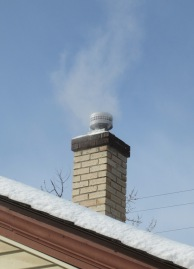 Calm down, all you ring-kissers. We don't have a new pope. That's just the furnace working overtime at Chez Dog.