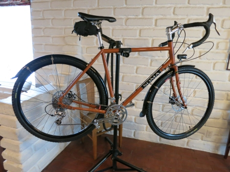 The latest iteration of the Soma Saga touring bike, this one with disc brakes and a dynamo headlight.