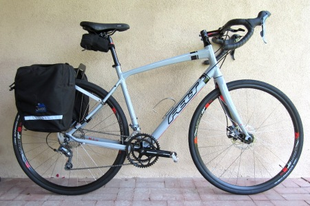 The Felt V100 is one of three bikes awaiting review for Adventure Cyclist. At $849, it's a cheap grocery-getter, even more so than a Honda Fit Sport.