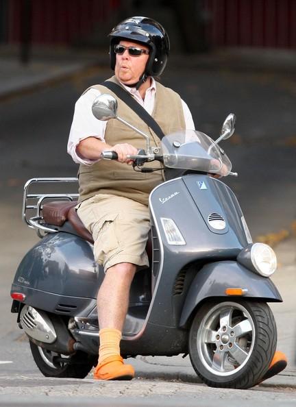 Mario Batali rides a Vespa