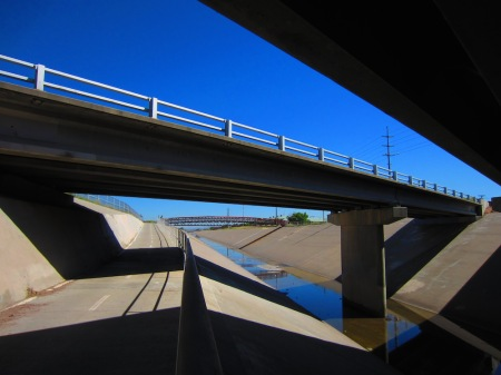 The view from underneath one of the many bridges crossing the North Diversion Channel Trail.
