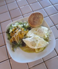 Thanksgiving Day breakfast: leftover taters smothered in green with eggs over easy, English muffins and a side salad.