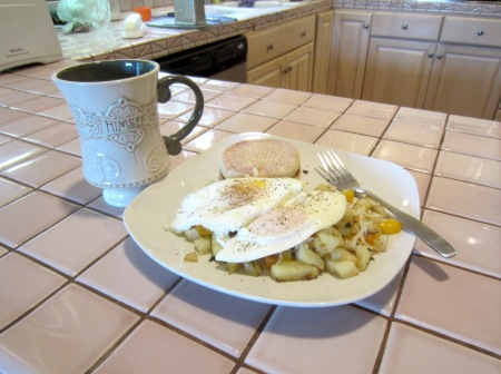 The fabled Three Pepper Hash, topped with two eggs over easy and a side of Lucky Irish Breakfast tea with lemon and honey.